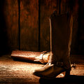 American West Rodeo Cowboy Boots on Old Wood Floor Royalty Free Stock Photography