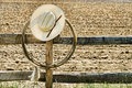 American West Rodeo Cowboy Hat and Lasso on Fence Royalty Free Stock Photography