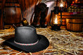 American West Rodeo Cowboy Hat in Old Western Barn Stock Photos
