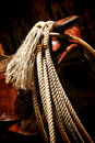 American west rodeo lariat on old western saddle roping lasso rope with tassel hanging an cowboy horn and swell Royalty Free Stock Images
