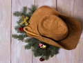 American western cowboy hat with christmas decoration on wood background Royalty Free Stock Images
