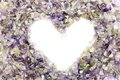 Amethyst i made form of the heart in the background of the Royalty Free Stock Photography