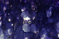 Amethyst macroshot blue background closeup Royalty Free Stock Images