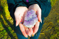 Amethyst in younger girl hands peace of a stone Stock Photo