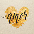 Amor spanish valentines day greeting card calligraphy lettering with gold paint heart on craft background hand drawn letters Stock Photography