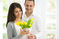 Amorous couple with bouquet of tulips together beautiful Stock Photo
