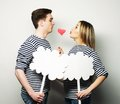 Amorous couple holding blank paper on stick love and family concept r Royalty Free Stock Images