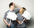 Amorous couple holding blank paper on stick love and family concept r Stock Photos