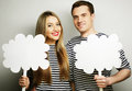 Amorous couple holding blank paper on stick love and family concept r Stock Photography