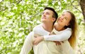 Amorous couple portrait of happy looking upwards in park Royalty Free Stock Photos