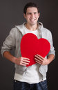 Amorous young man with red heart Stock Image