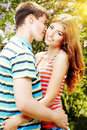 Amorousness beautiful young couple in love in a summer park love concept happiness Royalty Free Stock Images