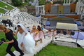 Amphitheater wedding plovdiv bulgaria bride and bridesmaids walk up the steep stairs of ancient roman in Royalty Free Stock Images