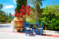 The amphora with flowers and traditional greek table chairs at luxury hotel crete greece Royalty Free Stock Photography