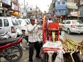 AMRITSAR, INDIA - MARCH 18, 2019: wide view of a sugar cane juice vendor and customers in amritsar Royalty Free Stock Photo