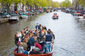 Amsterdam april king s day boating through canals on april in amsterdam the netherlands koningsdag is held birthday every year Royalty Free Stock Photography
