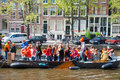 Amsterdam april king s day boating people have fun on the boats on april in amsterdam the netherlands koningsdag is held birthday Stock Images