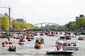 AMSTERDAM - APRIL 30: Lots of boats partying on the river Amstel at the celebration of kingsday on April 30, 2012 in Amsterdam, T