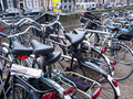 Amsterdam bicycles chained together in this is an iconic picture of the most recognizable feature of the dutch capital Stock Photo