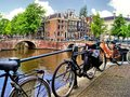 Amsterdam canal and bicycles Royalty Free Stock Photo
