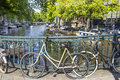 Amsterdam canal and bikes the netherlands Stock Photography