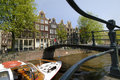 Amsterdam canal with boat Royalty Free Stock Photos