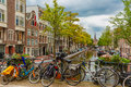 Amsterdam canal and bridge with bikes, Holland Royalty Free Stock Photo