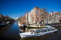 Amsterdam canal cruise boat sunny day Royalty Free Stock Photography