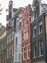 Amsterdam canal houses in different styles netherlands sept showing types of facades but all with pulleys for freight and painted Royalty Free Stock Photo