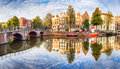 Amsterdam Canal houses vibrant reflections, Netherlands, panora Royalty Free Stock Photo
