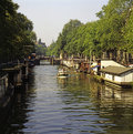 Amsterdam canal netherlands with boat in Stock Photos