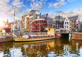 Amsterdam canal Netherlands. Traditional houses and bridge