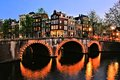 Amsterdam canal night scene houses of with bridge lit at netherlands Royalty Free Stock Photography