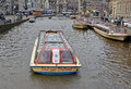 Amsterdam canalboat a with tourists in netherlands Royalty Free Stock Photography