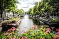 Amsterdam canals in holland is the cultural and commercial capital of the netherlands Royalty Free Stock Image