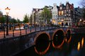 Amsterdam canals at night lit up dusk netherlands Stock Photo