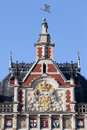 Amsterdam central station rooftop details with coat of arms of the netherlands Stock Photography