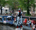 Amsterdam gay pride august participant at the water of the canals at festival netherlands Royalty Free Stock Images