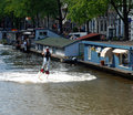 Amsterdam gay pride august participant at the water of the canals at festival netherlands Stock Images