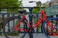 Amsterdam, Holland, August 2019. The red frame of a bike parked on a bridge captures the attention giving an image that is a Royalty Free Stock Photo