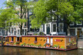 Amsterdam holland canal house boat with flowers Royalty Free Stock Photo