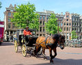 Amsterdam horse drawn carriage netherlands may in a street in the historical centre of on may in netherlands Stock Photos