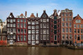 Amsterdam netherlands traditional dutch houses near canal in Royalty Free Stock Photography