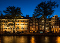 Amsterdam at night traditional houses in Stock Image