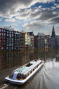 Amsterdam sightseeing canal with a tourism boat Stock Photography