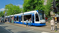 Amsterdam tram and people netherlands may at the stop on may in netherlands the network comprises lines Royalty Free Stock Images