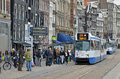 Amsterdam trams and people street scene from with environment friendly way of travel Royalty Free Stock Image