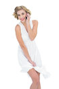 Amused fashion blonde model making a phone call on white background Royalty Free Stock Photos