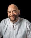 Amused mixed race man with beautiful eyes isolated on black Stock Image