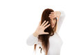 Amused young woman hides behind her hands Stock Photos